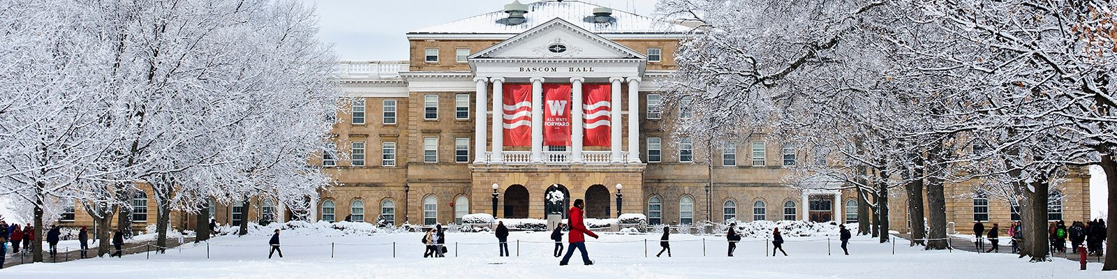 Students cross Bascom Hill in the winter
